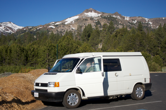 White eurovan camper van parked in front of mountains in the Sierra's.