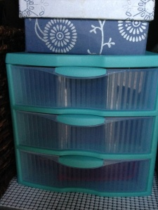 Turquoise plastic drawer organizer showing storage options for life in a van