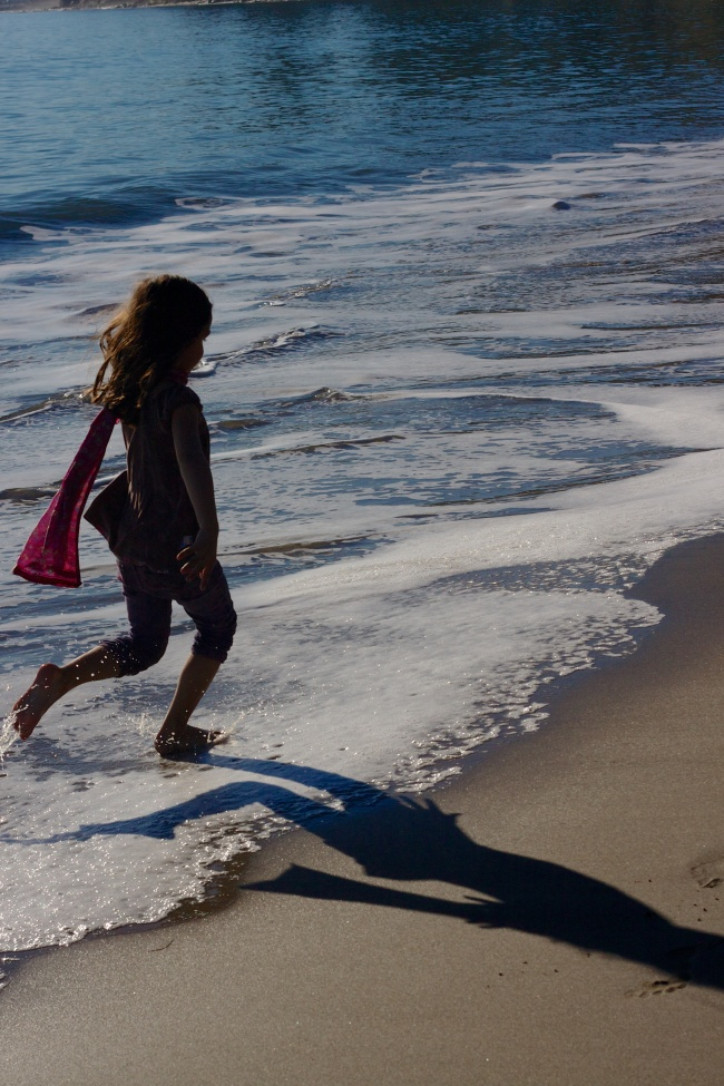 Young girl frolicking in the surf