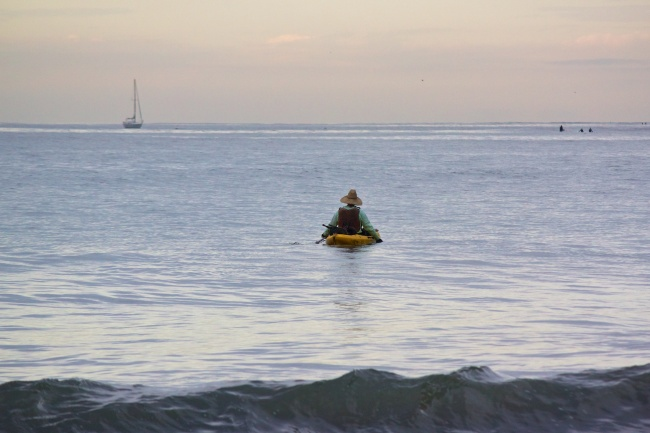 kayaker heading out to sea